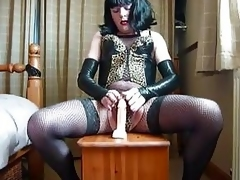 Bungling crossdresser playing with dildo